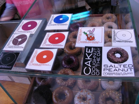 donuts under glass case, labelled