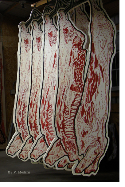hanging carcasses made from woodcuts adhered to polysterene